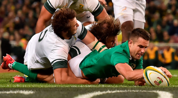 Conor Murray stretches to score Ireland's second try against South Africa despite the tackle of Lood de Jager. Photo: Brendan Moran/Sportsfile