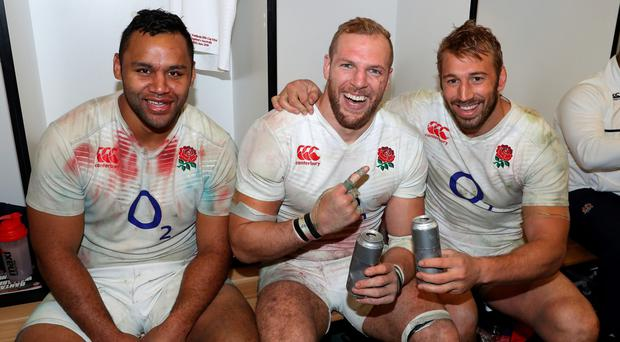 England's back-row, Billy Vunipola, James Haskell and Chris Robshaw, celebrate after their victory. Photo by David Rogers/Getty Images