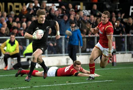 New Zealand All Blacks' Beauden Barrett runs in for his second try against Wales. Photo: AP