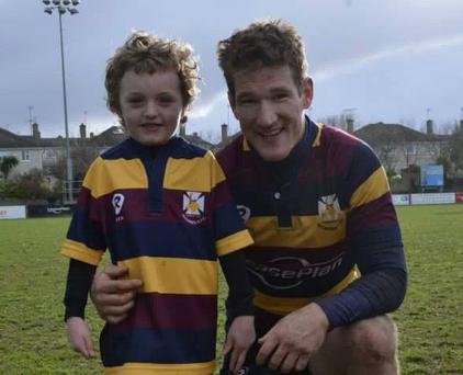 Recently-retired stalwart Chris Keane with a young supporter proving that Skerries RFC is a club for all ages