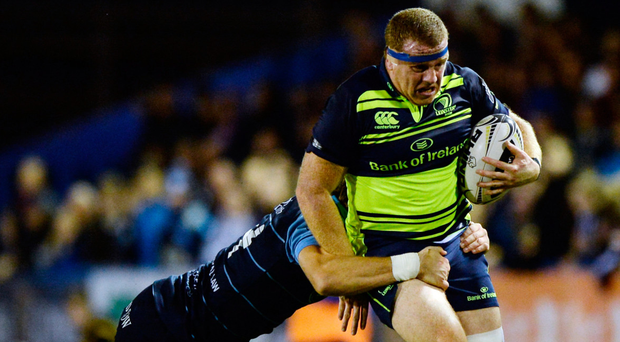 Sean Cronin is tackled by Cardiff Blues' Blaine Scully. Photo: Seb Daly/Sportsfile