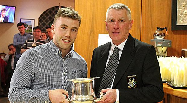 Longford Rugby Club's player of the year Dereck Farrell pictured receiving his trophy from Tony