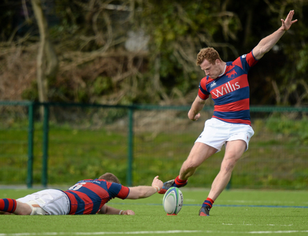 Clontarf's Rob Keogh scored an injury-time drop goal to deny Garryowen in the Ulster Bank League