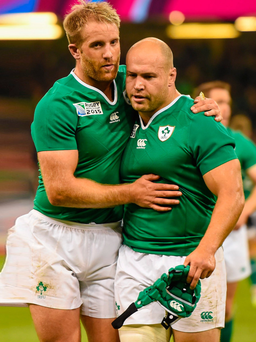 Luke Fitzgerald, left, and Richardt Strauss following Ireland's victory in the 2015 Rugby World Cup against France