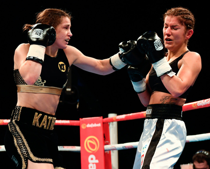 Katie Taylor lands a left to the head of Karina Kopinska during their super-featherweight fight at Wembley Arena. Photo: Stephen McCarthy