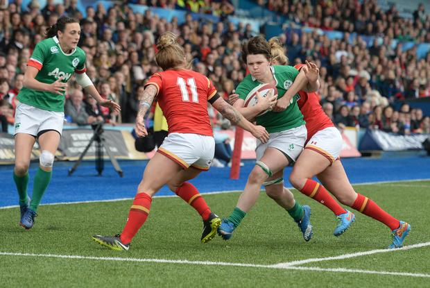 Ciara Griffin forces her way through the Welsh defence. Photo: INPHO