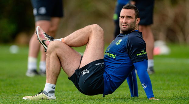 Dave Kearney doing some stretches at squad training. Photo: SPORTSFILE