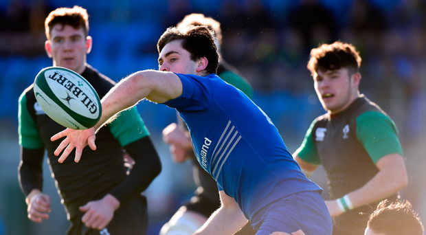 Conor O'Brien of the Leinster Development XV is tackled by Daniel Hurley of the Ireland Under-20 XV. Photo: Sportsfile