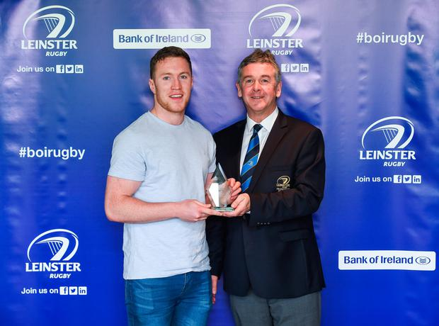 Rory O'Loughlin receives his Academy Graduation Trophy from Leinster Rugby president Frank Doherty at Milltown GC. MATT BROWNE /SPORTSFILE