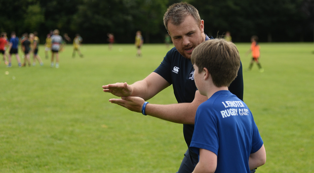 Corey Carty gives instructions at a King's Hospital camp. Photo: Sam Barnes/Sportsfile