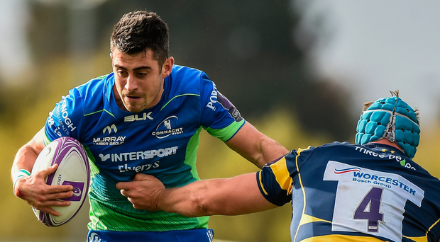Connacht's Tiernan O'Halloran is tackled by Pierce Phillips of Worcester Warriors. Photo: Sportsfile