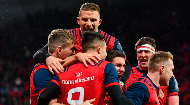 Munster players celebrate with Conor Murray after he grabbed his side's first try Photo: Sportsfile