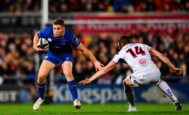 Jordan Larmour escaping the attentions of Ulster's Tommy Bowe last weekend. Photo: Ramsey Cardy/Sportsfile