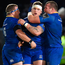 Andrew Porter, centre, of Leinster is congratulated by teammates Sean Cronin, left, and Jack McGrath after playing an integral part in his side's fourth try during the Guinness PRO14 Round 13 match between Leinster and Ulster at the RDS Arena in Dublin. Ph
