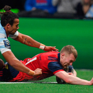 Munster's Keith Earls scores his side's second try despite the efforts of Racing 92's Teddy Thomas Photo: Sportsfile