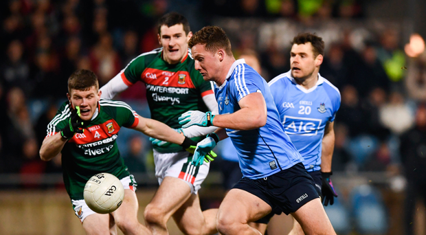 Dublin's Ciaran Kilkenny is first to the breaking ball during Saturday's Division 1 clash in Castlebar Photo: Sportsfile