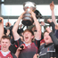 Glenstal Abbey captain Ben Healy lifts the Senior Cup