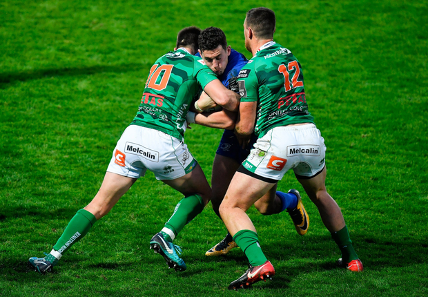 Noel Reid being tackled by Tommaso Allan and Alberto Sgarbi of Benetton Treviso. Photo: Brendan Moran/Sportsfile