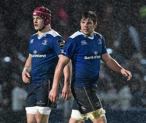 Josh van der Flier in action alongside departing back-row colleague Jordi Murphy. Photo: SPORTSFILE