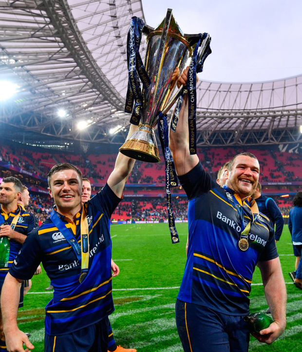 Luke McGrath celebrating with Jack McGrath and the European Champions Cup trophy. Photo: Sportsfile