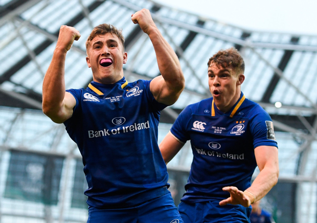 Jordan Larmour celebrates with team-mate Garry Ringrose after scoring his side's fourth yesterday. Photo: Ramsey Cardy