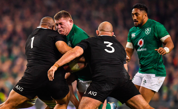 Tadhg Furlong is tackled by New Zealand's Karl Tu'inukuafe and Owen Franks. Photo: Sportsfile