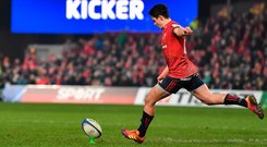 Joey Carbery kicks one of the three penalties that got Munster over the line against Exeter in Thomond Park yesterday. Photo: Brendan Moran