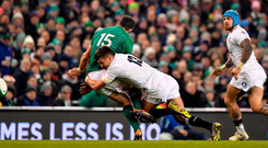 Robbie Henshaw is robbed of possession after being tackled by Henry Slade during the Six Nations game at the Aviva Stadium. Photo: Sportsfile