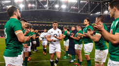 Grand Slammed: Ireland players applaud Owen Farrell and his England team-mates off the pitch after the opening Six Nations game at the Aviva Stadium. Photo: Brendan Moran/Sportsfile