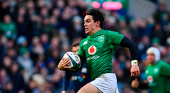 Joey Carbery makes a break on his way to setting up Ireland's crucial third try, scored by Keith Earls, in yesterday's win over Scotland at the BT Murrayfield Stadium in Edinburgh. Photo: Ramsey Cardy/Sportsfile