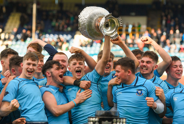Former St Michael's players Dan Leavy and Ross Byrne enjoyed seeing captain Mark Hernan lift the Senior Cup for their old school as well as their Junior Cup victory. Photo: Sportsfile