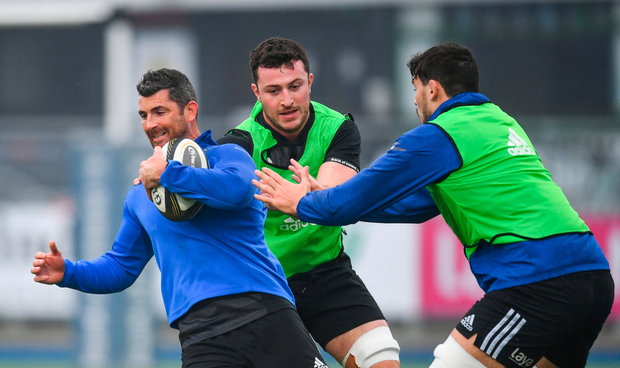 Rob Kearney is tackled by Will Connors, left, and Max Deegan during Leinster squad training at Energia Park in Donnybrook, Dublin. Photo by Ramsey Cardy/Sportsfile