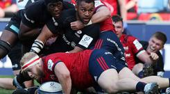 Billy Vunipola, supported by Maro Itoje, looks to the referee to confirm he has gone over for Saracens' second try despite the efforts of Munster's Jeremy Loughman. Photo: Reuters/John Clifton
