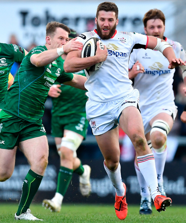 Ulster's Stuart McCloskey is tackled by Connacht's Jack Carty during last night's PRO14 quarter-final at Kingspan Stadium. Photo: Brendan Moran