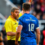 Referee Jerome Garces speaking with Jonathan Sexton last weekend. Photo: Sportsfile
