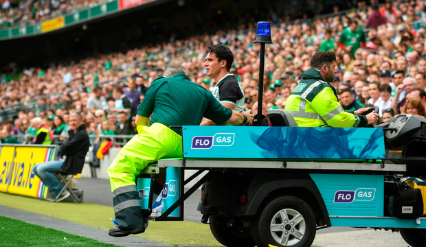 Joey Carbery leaves the field with an ankle injury during yesterday's World Cup warm-up match against Italy at the Aviva Stadium. Photo: David Fitzgerald