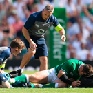 Cian Healy is treated for an ankle injury before being forced off the field in Ireland's record defeat to England at Twickenham yesterday. Photo: David Ramos/Getty
