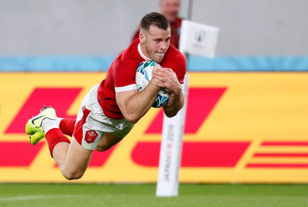 Wales' Gareth Davies dives over to score his side's second try in their victory over Australia. Photo: Reuters/Issei Kato