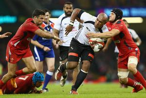 Nemani Nadolo (C) of Fiji powers his way past Mike Phillips (L) and Nicky Smith (R) of Wales during the International match between Wales and Fiji at the Millennium Stadium