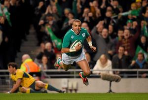 Simon Zebo, Ireland, sprints past Nick Phipps, Australia, to score his side's first try