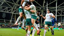 Ireland's Tommy Bowe is congratulated by team-mates Conor Murray, left, and Richardt Strauss after scoring his side's second try