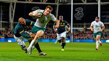 Tommy Bowe, Ireland, scores his side's second try of the game despite the tackle of Bryan Habana, South Africa