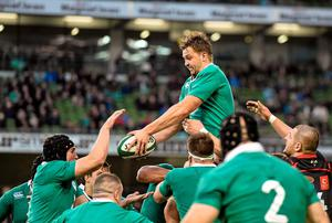 Ireland's Dave Foley gets the ball to team-mate Tommy O'Donnell
