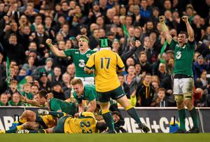 Jamie Heaslip and Peter O'Mahony, Ireland, celebrate after Ian Madigan, below centre, turns over the ball at the end of the game