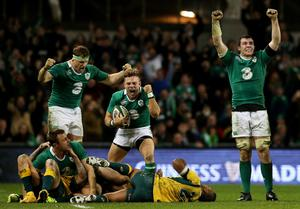 Jamie Heaslip, Tommy Bowe, Ian Madigan, and Peter O'Mahony celebrate in the dying seconds of the match at the Aviva Stadium