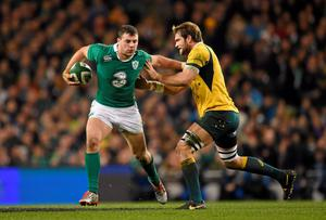 Robbie Henshaw, Ireland, is tackled by Ben McCalman, Australia