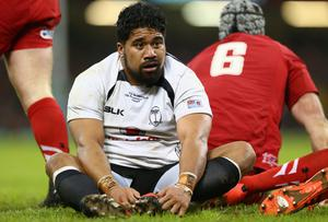 Campese Ma'afu of Fiji lsits on the turf after a scrum breakdown which he was penalised and sin binned by referee Pascal Gauzere during the International match between Wales and Fiji at the Millennium Stadium