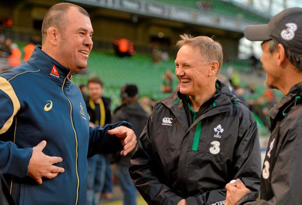 Joe Schmidt shares a joke with Australian counterpart Michael Cheika