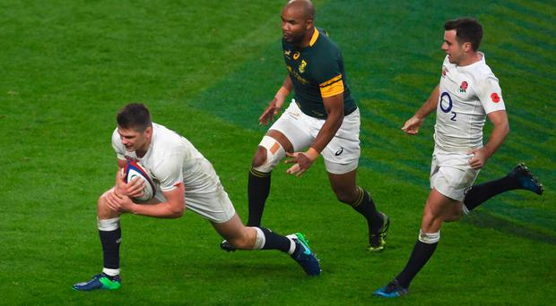England's Owen Farrell dives to score his team's fourth try against South Africa Picture: Getty
