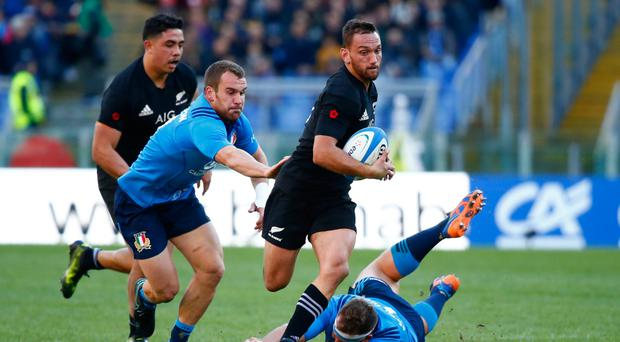 New Zealand's Aaron Cruden in action against Italy's Andrea Lovotti yesterday Picture: Reuters